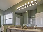 There's plenty of space for 2 to get ready in the master bathroom.