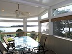 Enjoy the breeze and the views as you sit at the screened in porch that sits 10