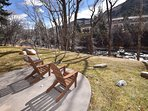 Shared fire pit area with Adirondack chairs facing river