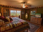 Master bedroom - King bed - custom made local barn wood bed and dresser~  sitting area with views!