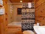 Main Level Bathroom with Large Jetted Tub and Shower - Relax and Unwind after a Long Day Shopping and Enjoying...
