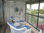 Large Lanai with Lounge Chairs and Dinette Table for 4