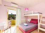 Twin bedroom with bunk beds! All bedrooms are air conditioned!