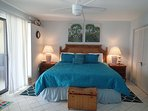 King size master bedroom with immediate access to balcony. 40 inch TV in bedroom.