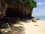 pristine white sand beach below the villa
