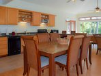 Enter into the great room, combining open kitchen, dining and living areas