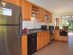 The L shaped kitchen features high end, modern appliances