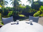 An lanai table provides an outdoor dining option