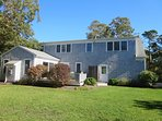Back of home with nice yard- deck- and enclosed out door shower. - 118 Deep Hole Road South Harwich Cape Cod New...