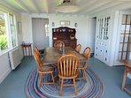 The dining room with the kitchen and living room off to the right - 30 Seabeach Road Chatham Cape Cod New England...