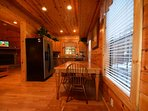 Spacious Dining and Easy Open Access from Kitchen to Living Area in the Cabin