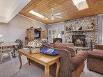 Cozy up to the beautiful wood burning stone fireplace.
