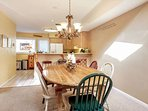 Enjoy a meal or family game at this dining table that seats 6 guests.
