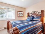 Bedroom 2, located on the entry level, features a queen bed and south facing views.