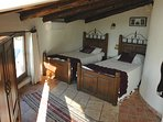 Top bedroom with 2 single beds and on suite bathroom