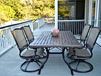 Outdoor dining on deck. Another table in screened porch.