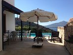 Two pool deck patios both fully furnished with parosols & lounge chairs! Outside dining also!