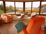 Conservatory offers spectacular sea and mountain views.