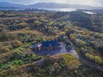 House enjoys a spectacular setting, surrounded by acres of private woodland, with Kenmare Bay behind