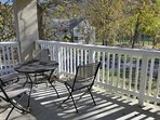 Private Covered Deck with Table for Four, Overlooking the Playground and Lake Taneycomo.