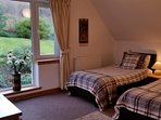 Spacious twin bedroom with en-suite. Lovely views over the back garden and hillside.