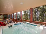 Enjoy the view of the forest while relaxing in your hot tub.