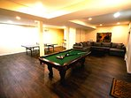 Fully finished basement with ping pong table, pool table, and outdoor access
