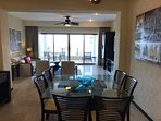 Main living area is open concept and opens to large patio overlooking the beach and bay.