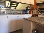 Kitchen - with juicer, coffee maker, wine fridge and more.