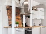 The kitchen with the integrated chimney
