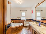 En-suite bathroom with two sinks, shower and jacuzzi