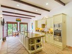Large kitchen with all amenities, island and dining table