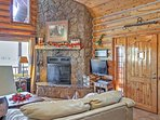 The charming cabin features 3 bedrooms, 3.5 bathrooms and space for 12.