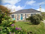 Large and cosy 5 star awarded house with garden, with fantastic views overlooking the Atlantic ocean