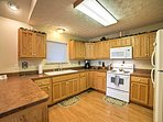 The granite topped kitchen includes all of the necessary cooking appliances needed to concoct scrumptious meals!