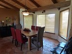 Large dining table with 6 comfy chairs
