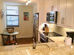 Kitchen with Stainless Steel Appliances, and upgraded Quartz   Counter Top Bar