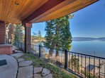 On the lower-level patio, partake in a relaxing soak in your hot tub as you enjoy a view of the lake.