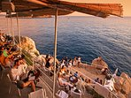 Enjoy a drink, the stunning views and beautiful sunset on the sea from Buza bar Old Town