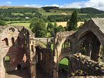 Take the stairs to the top of  Melrose Abbey