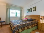 A cosy bedroom with a comfortable double bed