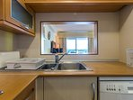 A fully equipped kitchen with microwave, coffe-maker, dishwasher etc
