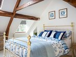 The lovely master bedroom, with a king size bed