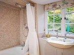 Family bathroom, with bath and overhead shower