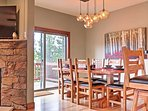 There's enough room for everyone in your party to dine in style at the lovely wooden dining table.