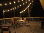 Deck with dining, seating and special lights for evenings.