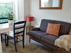 comfy sofa, and table which can seat up to four.