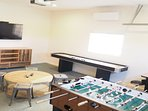 Enjoy the game room with foosball, shuffleboard and an arcade table!