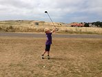 Golf on the nearby children's course looking towards Gullane Hill