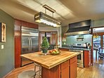 The kitchen has plenty of space to prepare your favorite meals.